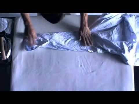 [GarraStyle] A man ironing a shirt