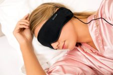 Blonde Woman sleeping with hibermate headphones for sleep and asmr