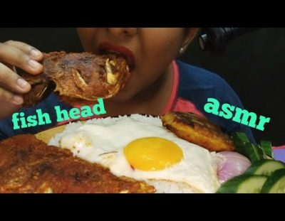 Eating fish head with rice